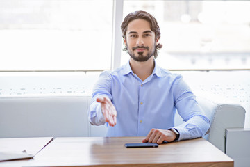 Confident man proposing to sit down