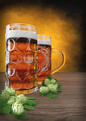 two glasses of oktoberfest beer with barley and hops on table - 3D render