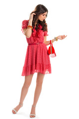 Girl in red casual dress. Short summer dress with belt. Model with slim figure. Thoughtful girl on white background.