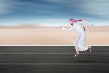 Arabic young businessman running on street