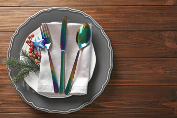 Beautiful table setting on wooden background