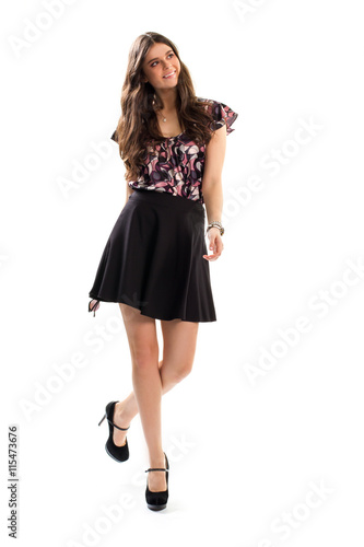 66b9a2d5a6f Woman in printed blouse smiling. Black skirt and high heels. Good-looking  fashion model. Casual outfit idea for spring.