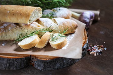 Photo sur Aluminium Snack Homemade baguette with Rosemary on rustic wooden background