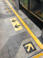 A view of arrows on platform in a long view. Taken on July 3, 2016 at BTS Chong Nonsi station in Bangkok Thailand.