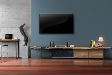 Led tv on dark blue wall with wooden table in living room