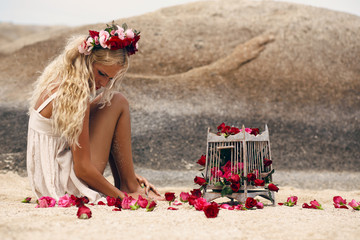 Retro vintage style image of beautiful blonde woman with roses a