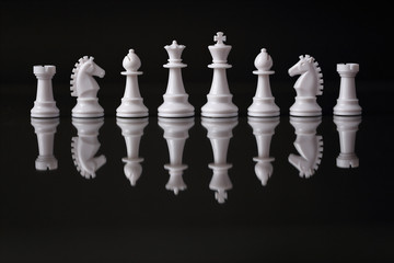 Teamwork, Chess pieces in a row, black background