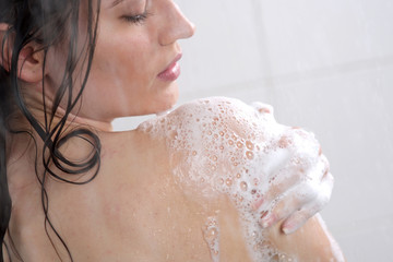 Woman washing her body shower gel