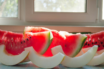 Slices of watermelon and melon