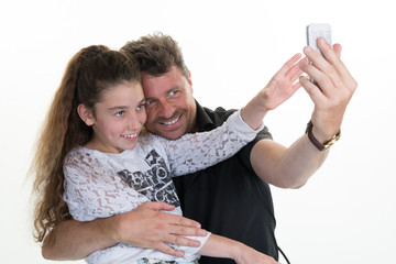Happy smiling father and child using tablet making selfie