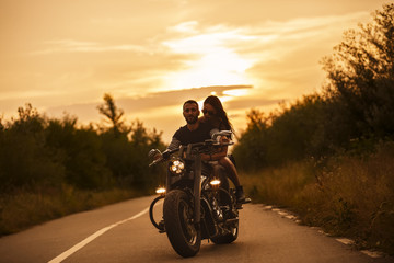 Romantic picture with a couple of beautiful young bikers