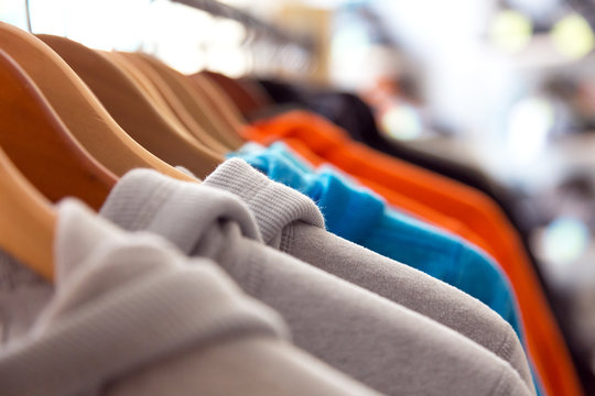 Row of Spring Seasonal Apparel on Hangers of Retail Shop