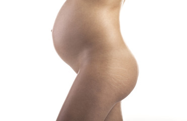 Pregnant woman with stretch marks on the buttocks