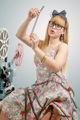 sexy pin-up with a film reel and cinema projector