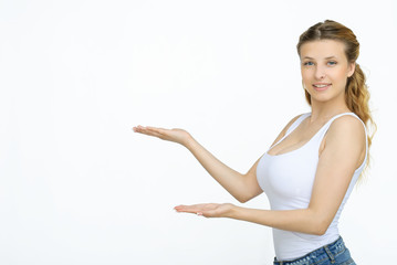 Woman showing something with open hand palm
