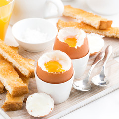 delicious breakfast with boiled eggs and crispy toasts