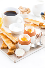 delicious breakfast with boiled eggs and crispy toasts, vertical