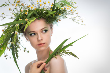 girl wearing a wreath of wildflowers