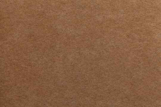 Brown old paper background. Thick cardboard.