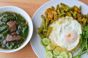 spicy stir fried yard long bean with fat pork curry topping egg and boiled pork blood soup