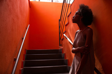 Afro Woman Waiting at the Stairs
