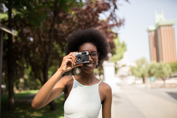 Afro Woman Taking Pictures in the Street