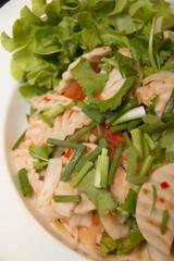 Thai cuisine spicy pork salad on  dish