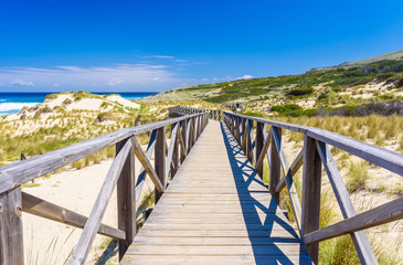 Foot bridge at Cala Mesquida - beautiful coast of island Mallorca, Spain