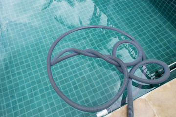 Swimming pool vacuum hose after pool cleaning