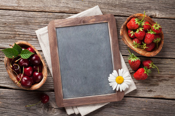 Blackboard for your text and berries