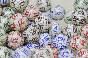 Several multi-colored bingo balls.