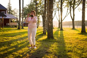 Sweden, Varmland, Senior woman taking photo