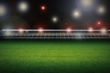 empty soccer field with stadium at night