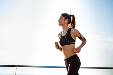 Picture of young attractive fitness girl jogging