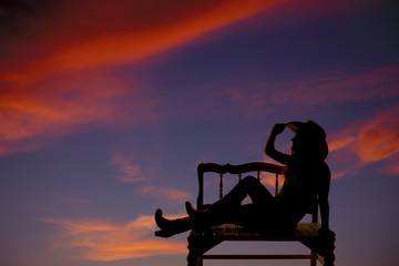 western girl on bench silhouette