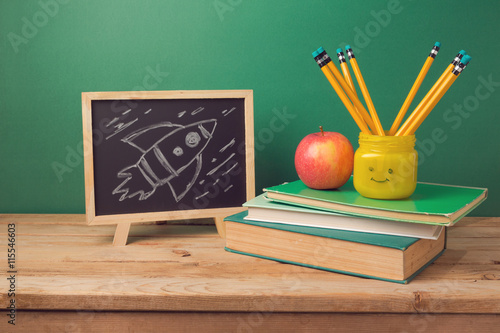 Back To School Background With Books Pencils In Emoji Jar Apple Chalkboard And