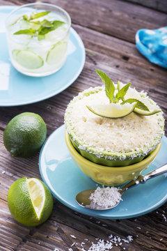 Lemon mug cake with sugar glaze on a wooden table.
