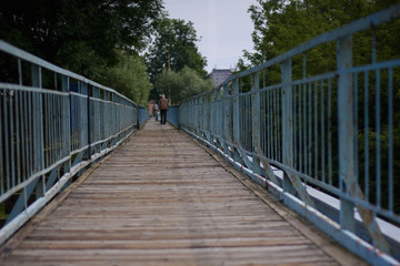 View along a long old footbridge with railings on either side