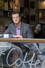Sweden, Stockholm, Businessman sitting in cafe