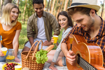 Happy young people making picnic