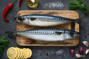 Raw mackerel on a dark background.