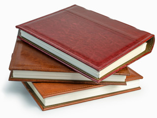 The pile of three photo books on white backround