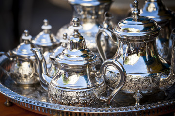 Table setting with silver tea or coffee cups