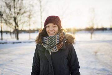 Sweden, Vasterbotten, Umea, Portrait of young woman in winter
