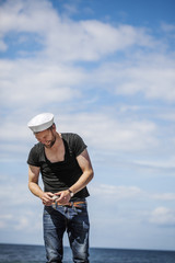 Denmark, Smiling man against cloudy sky