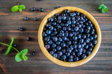blueberries in a bowl on wooden table