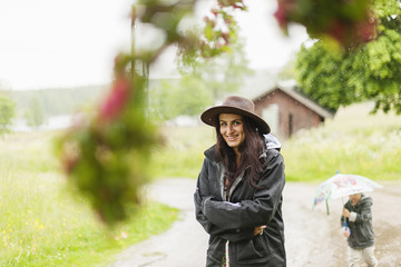Sweden, Varmland, Filipstad, Gasborn, Horrsjon, Portrait of woman standing in rain