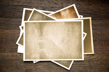 Vintage photos on wooden background