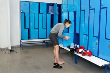 Side view of female boxer in locker room