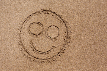 Smiley Dessin sur le Sable